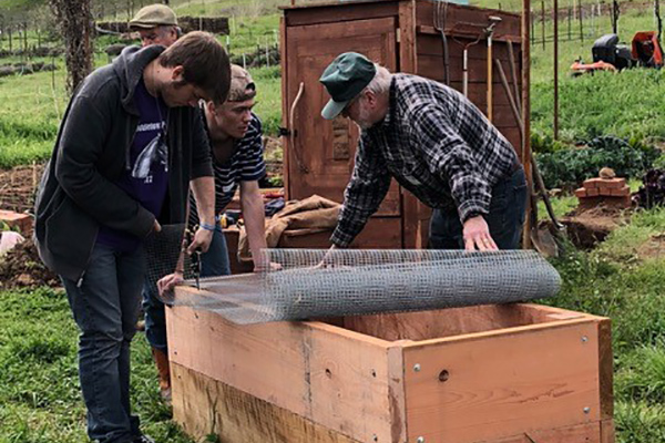 John-Ron-build-raised-beds-with-Independent-High-students